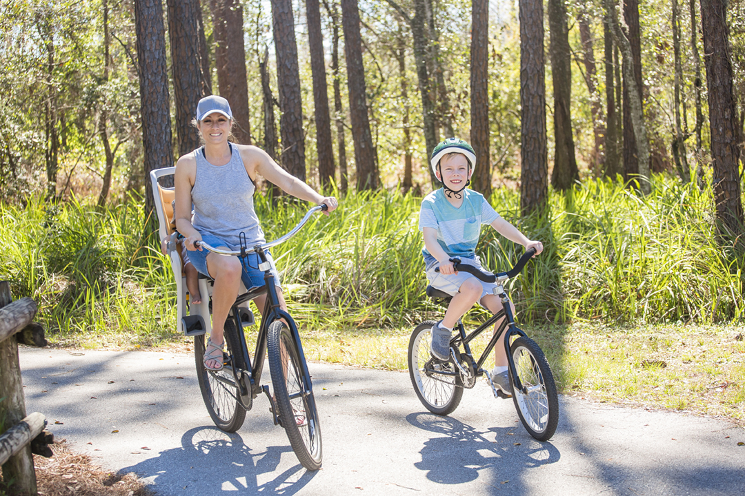 Family on a bike ride together outdoors on a sunny day